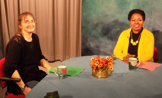 Jennifer Horne sits with Henrietta J. Burroughs on TV show
